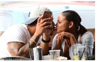 Christina Milan and new man kissing