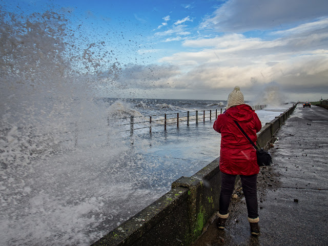 Photo of me photographing the rough sea on Maryport Promenade