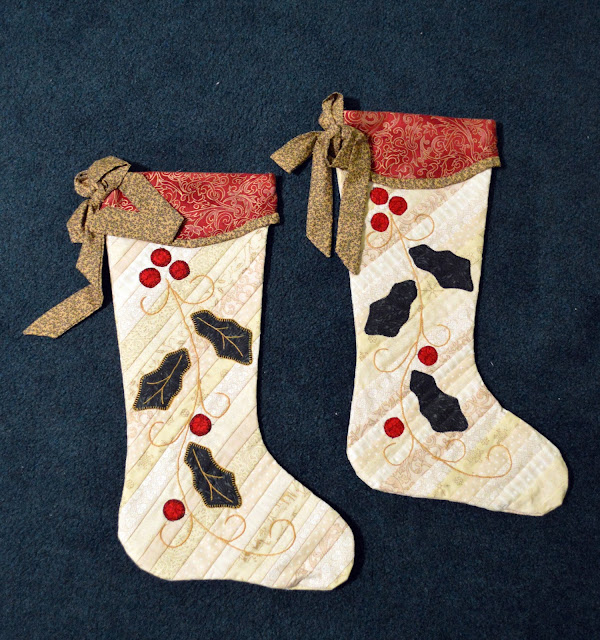 String quilted Christmas stockings  with holly applique.