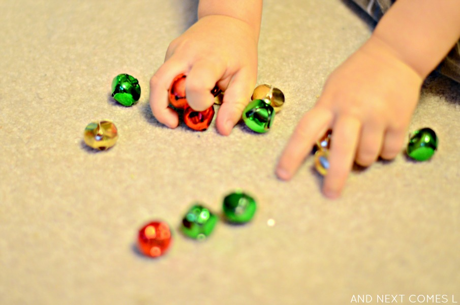Christmas busy box: playing with jingle bells from And Next Comes L