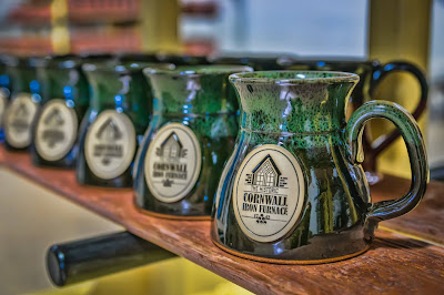 Green-stoneware-mugs-from-Cornwall-Iron-Furnace-store