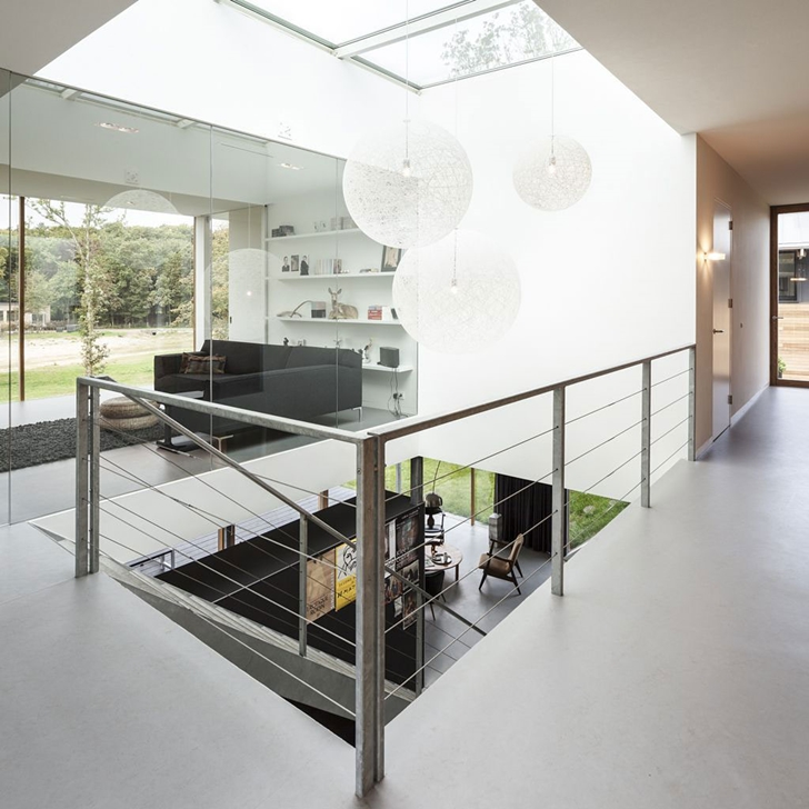 Steel railing in Modern Villa V by Paul de Ruiter Architects