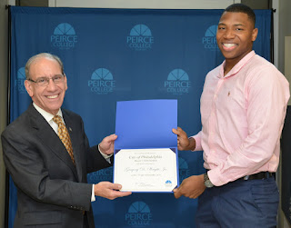 Gregory Wright receiving his scholarship for college