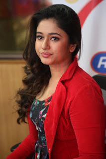Poonam Bajwa Stills At Radio City In Red Dress (10)