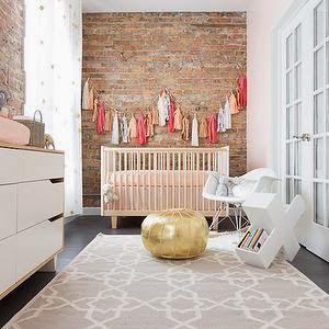 rustic nursery with gold detail and tassel garland