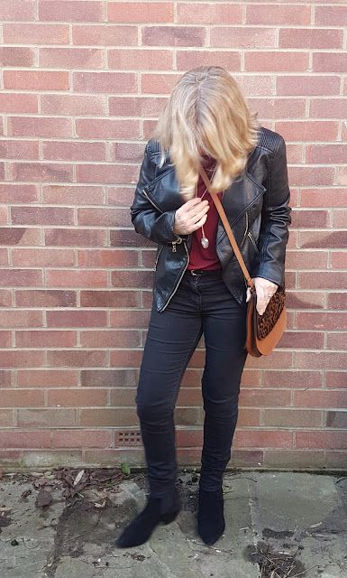 leopard print bag outfit with moto jacket