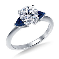 https://www.b2cjewels.com/1/gsus1061/three-stone-blue-sapphire-trillion-accented-diamond-engagement-ring-in-14k-white-gold