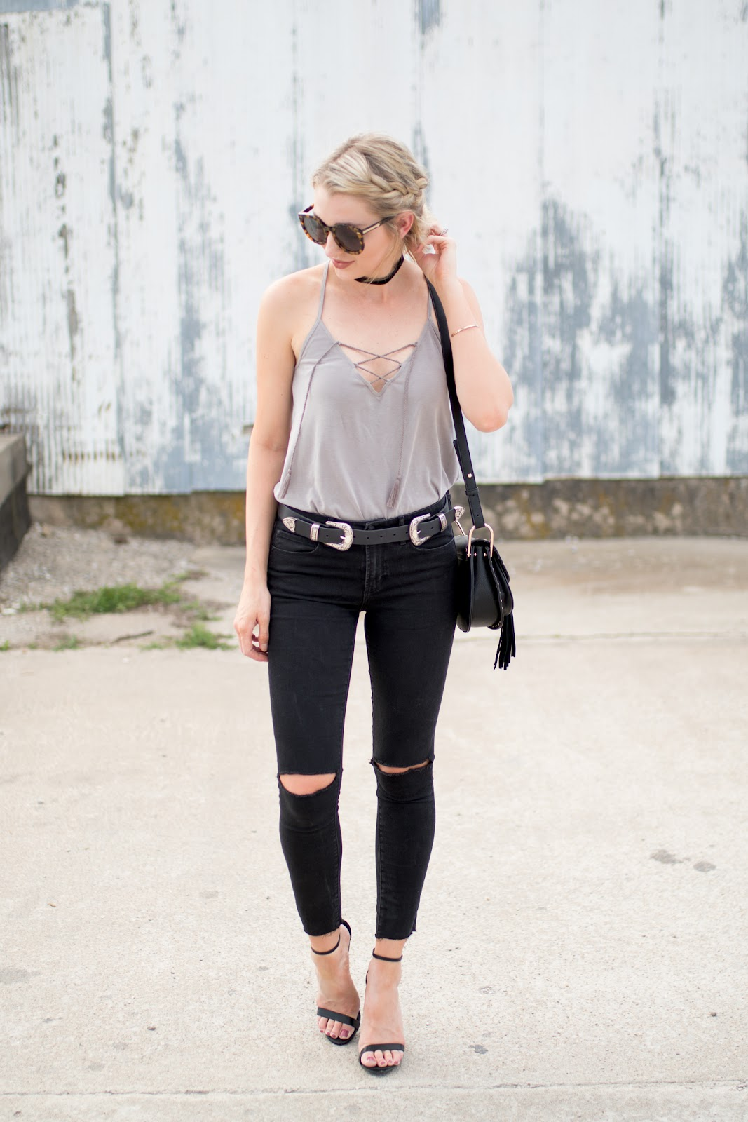 Tank top tucked into high-waisted jeans