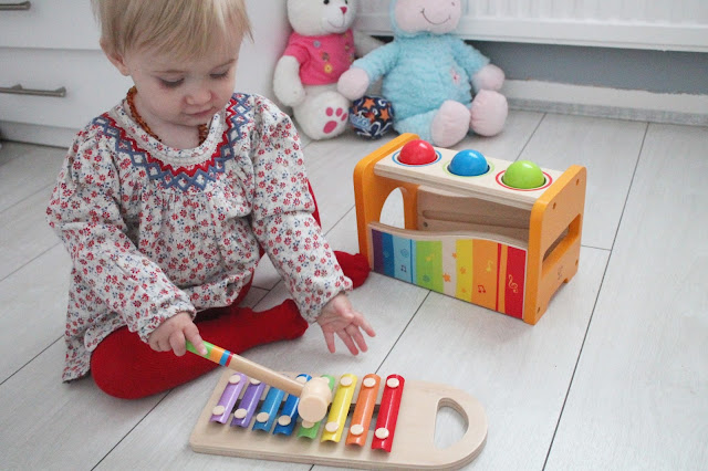 baby girl playing with xylophone