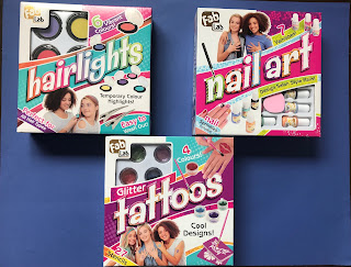 The boxes of the FabLabs hairlights, nail art and glitter tattoos