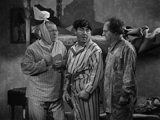 The Three Stooges I Can Hardly Wait pulling Curly's tooth