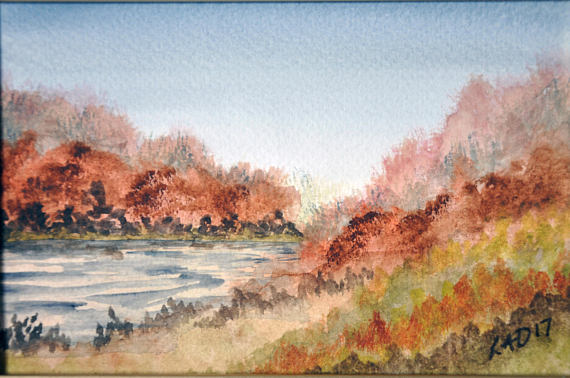 a watercolour scene of a river and surrounding hedges in autumn, with a grey sky and brown foliage