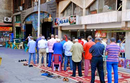 Men Praying in the Street Cairo Egypt
