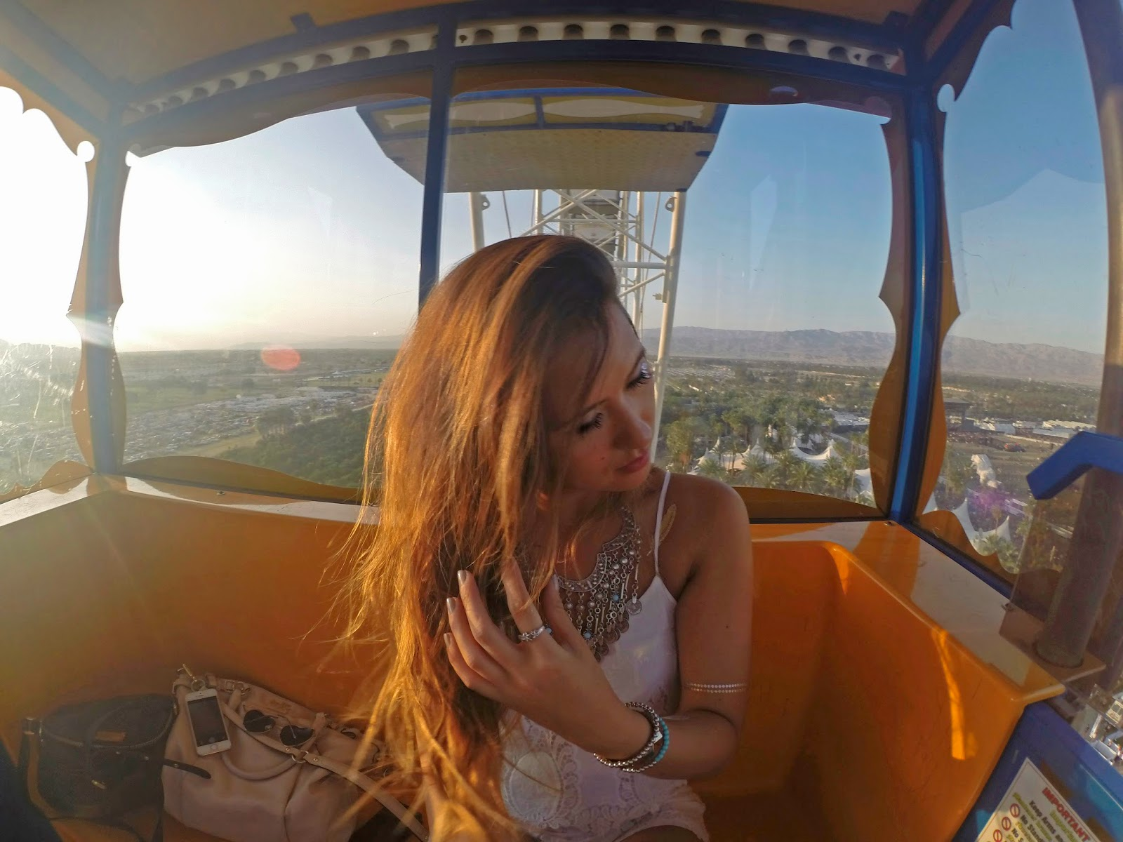 Fashion Blogger Boho Nouveau in the Coachella ferris wheel - Peace & Love: Coachella Outfits by popular Orlando fashion blogger Mash Elle