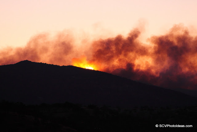 Dawn colors with wildfire visible