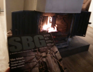 Reading a magazine in front of the open fire