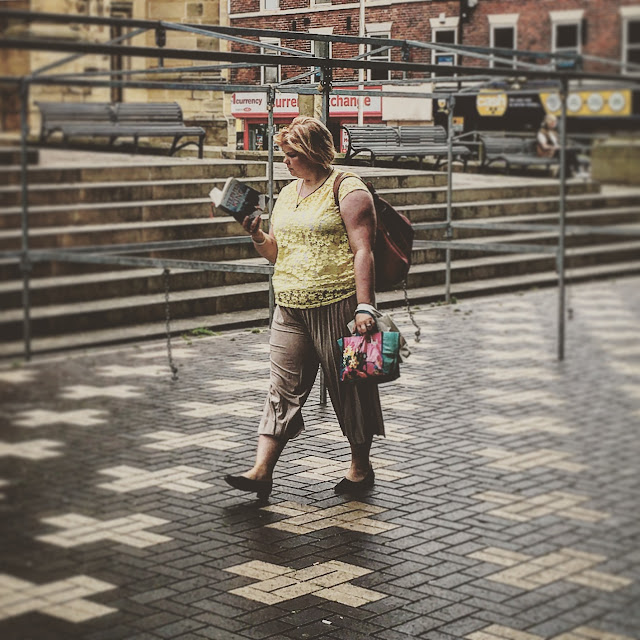 Woman walking while reading