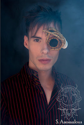 Cool steampunk monocles/monoggles made from latex of a skeleton hand holding the monocle to your face. for steampunk and gothic costume and cosplay