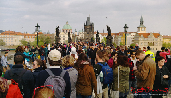 Crowd crush, the Charles Bridge in Spring Prague by Travel and Lifestyle Photographer Kent Johnson.