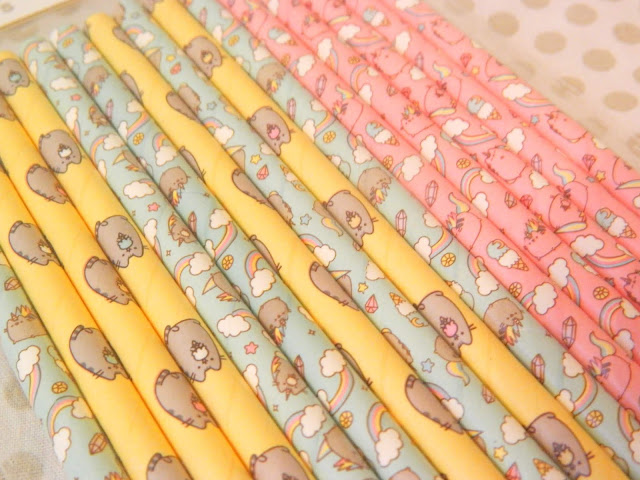 A photo of a selection of Pusheen paper straws with cute designs on them