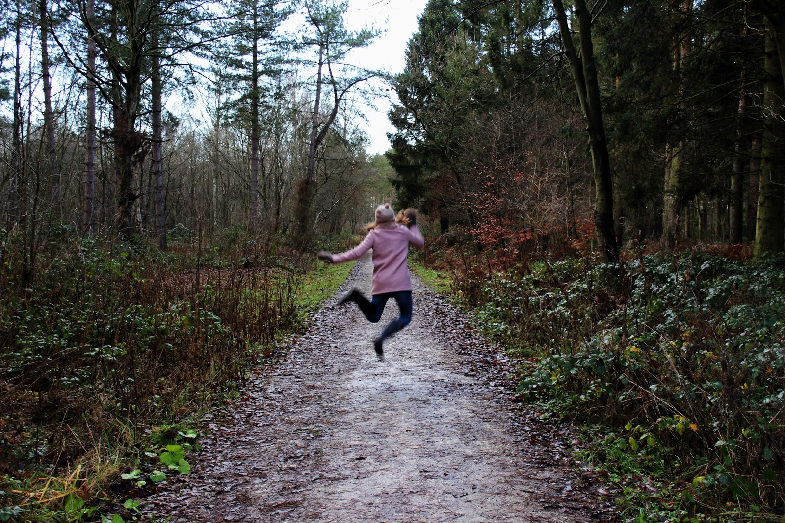 beth-jumping-in-the-woods