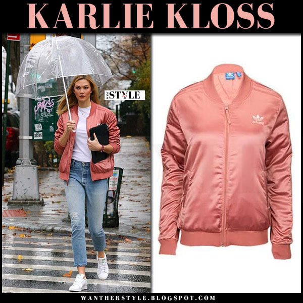 Karlie Kloss in pink satin adidas jacket, jeans and white sneakers what she wore