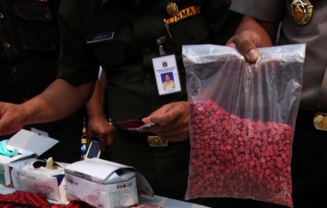 Yeung Man Fung pembawa ratusan ribu pil ekstasi lolos dari hukuman mati