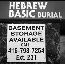 Funny funeral sign photo - Hebrew basic burial - Basement storage available