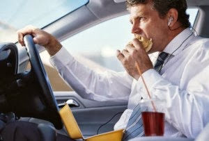 man eating in car 300x203