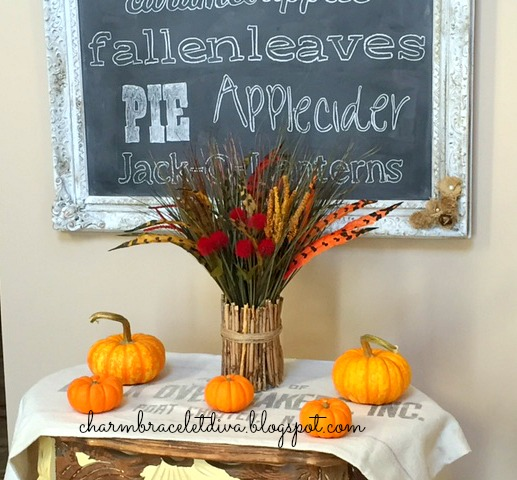 Fall foyer Dollar Tree faux flowers and feathers with fallart chalkboard