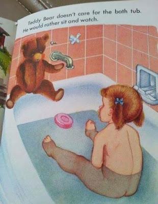 little naked girl in bathtub that looks naughty