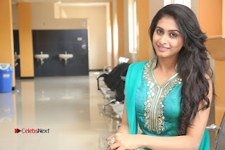 Actress Nithya Pictures in Green Salwar Kameez at Nandini Nursing Home Audio Success Meet  0203