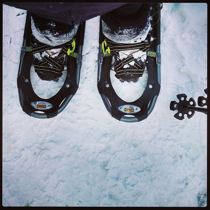 picture of Kirsten's big feet in a pair of snowshoes