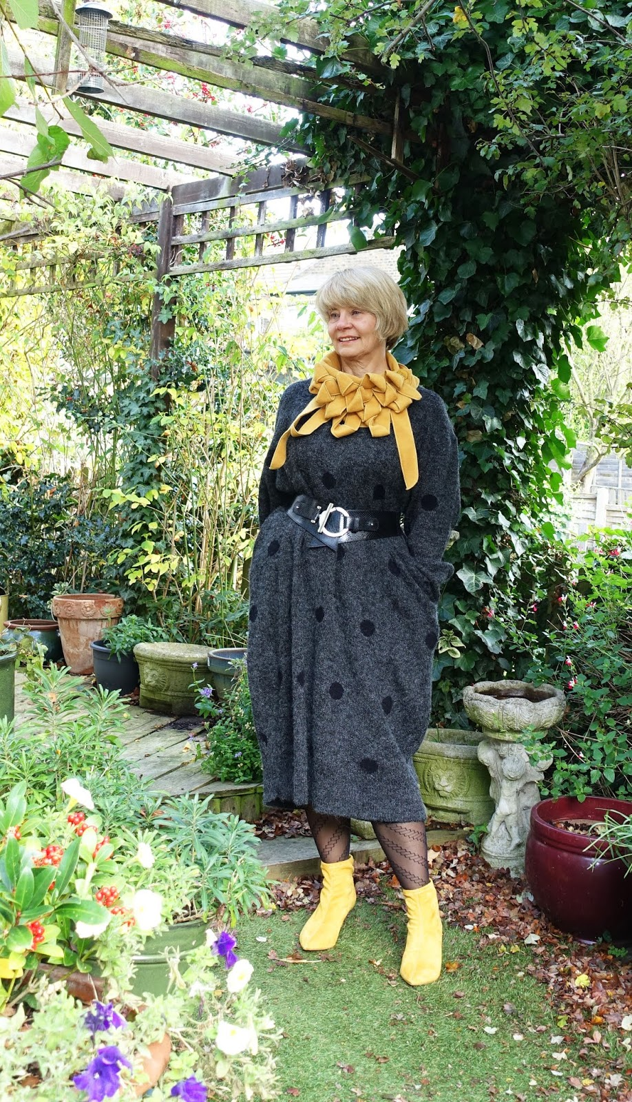 Over 45s blogger Gail Hanlon in midi grey sweater dress from Eva Trends worn with mustard boots and collar