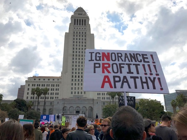 March For Our Lives LA NRA Ignorance Profit Apathy sign