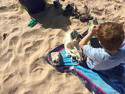 Boy with autims on the beach