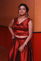 Tamil Actress Anisha Xavier Pos in Red Dress at Pichuva Kaththi Tamil Movie Audio Launch  0015.JPG