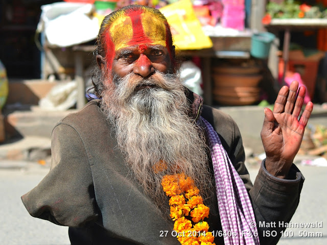 people, closeup, street portrait, Nepal, Kathmandu, sadhu, Hinduism, holy man, religious ascetic, yogī, mokṣa, amputated right arm, raised left hand, blessing