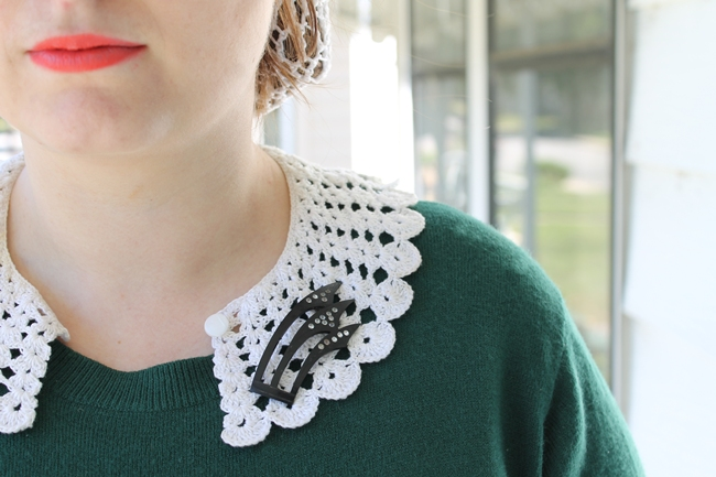 1930s art deco celluloid brooch on white crochet scalloped peter pan collar
