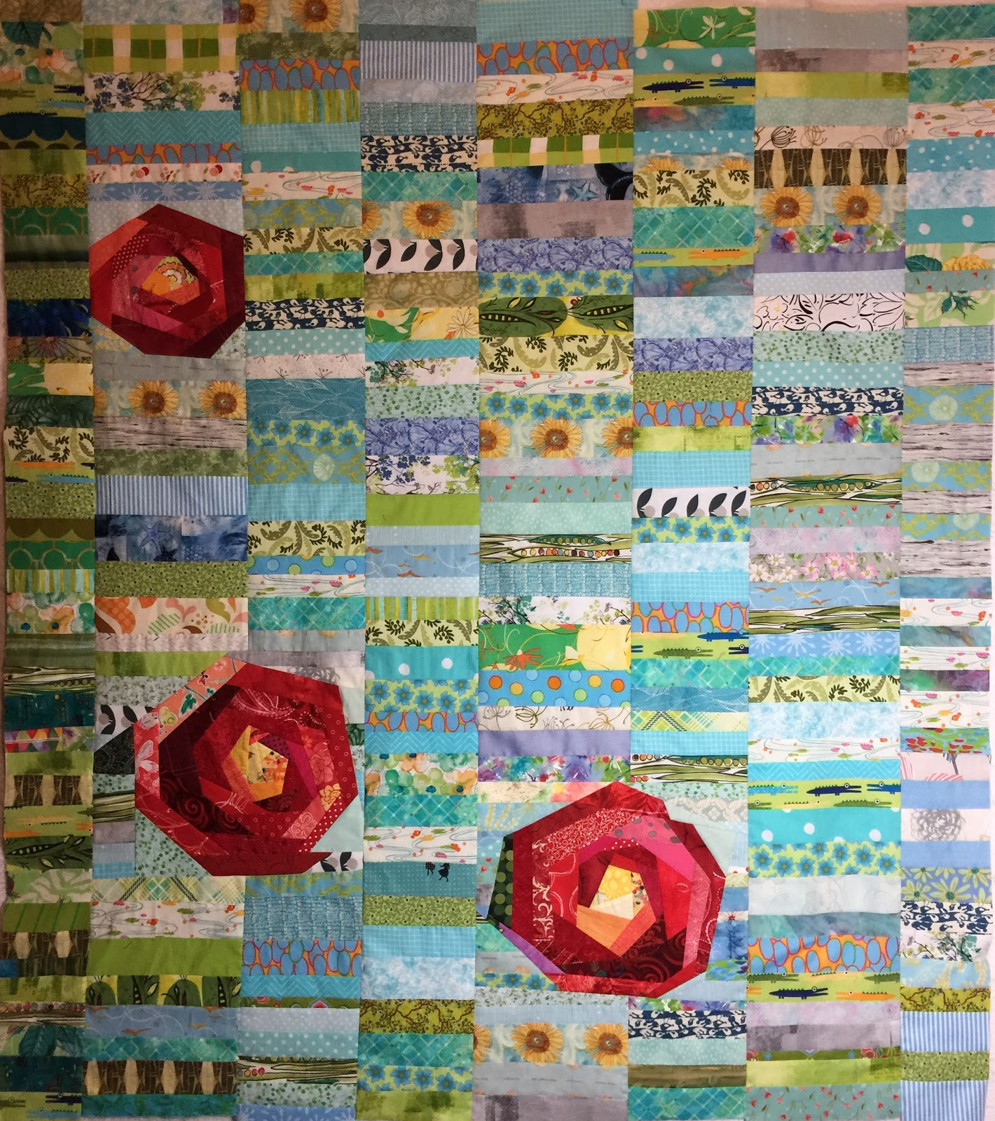 quilt with chinese coins background and pieced roses