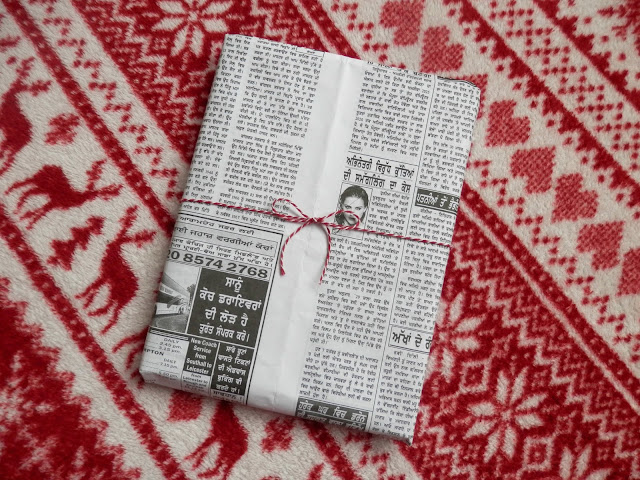 Wrap presents with newspaper and fabric.  Make one small change - ditch the wrapping paper.  secondhandsusie.blogspot.co.uk