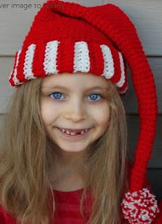 http://www.craftsy.com/pattern/crocheting/accessory/free-crochet-santa-hat-elf-pixie--vid/38423