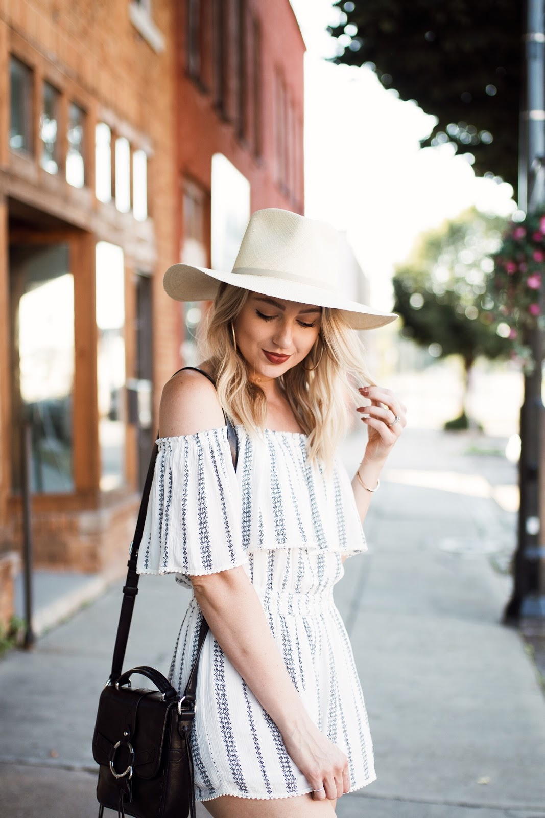 blue & white off-the-shoulder romper + a wide brim straw hat // 4th of July outfit idea