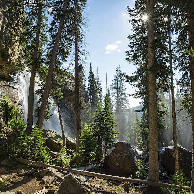 Ouzel Falls with a sunburst in Rocky Mountian National Park, Colorado