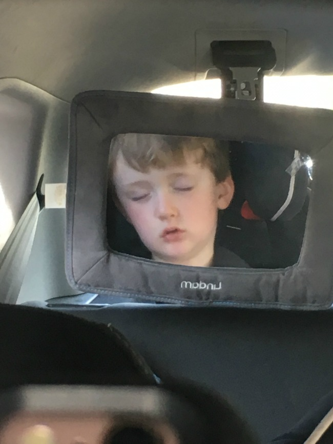 Our-Weekly-Journal-boy-sleeping-in-car