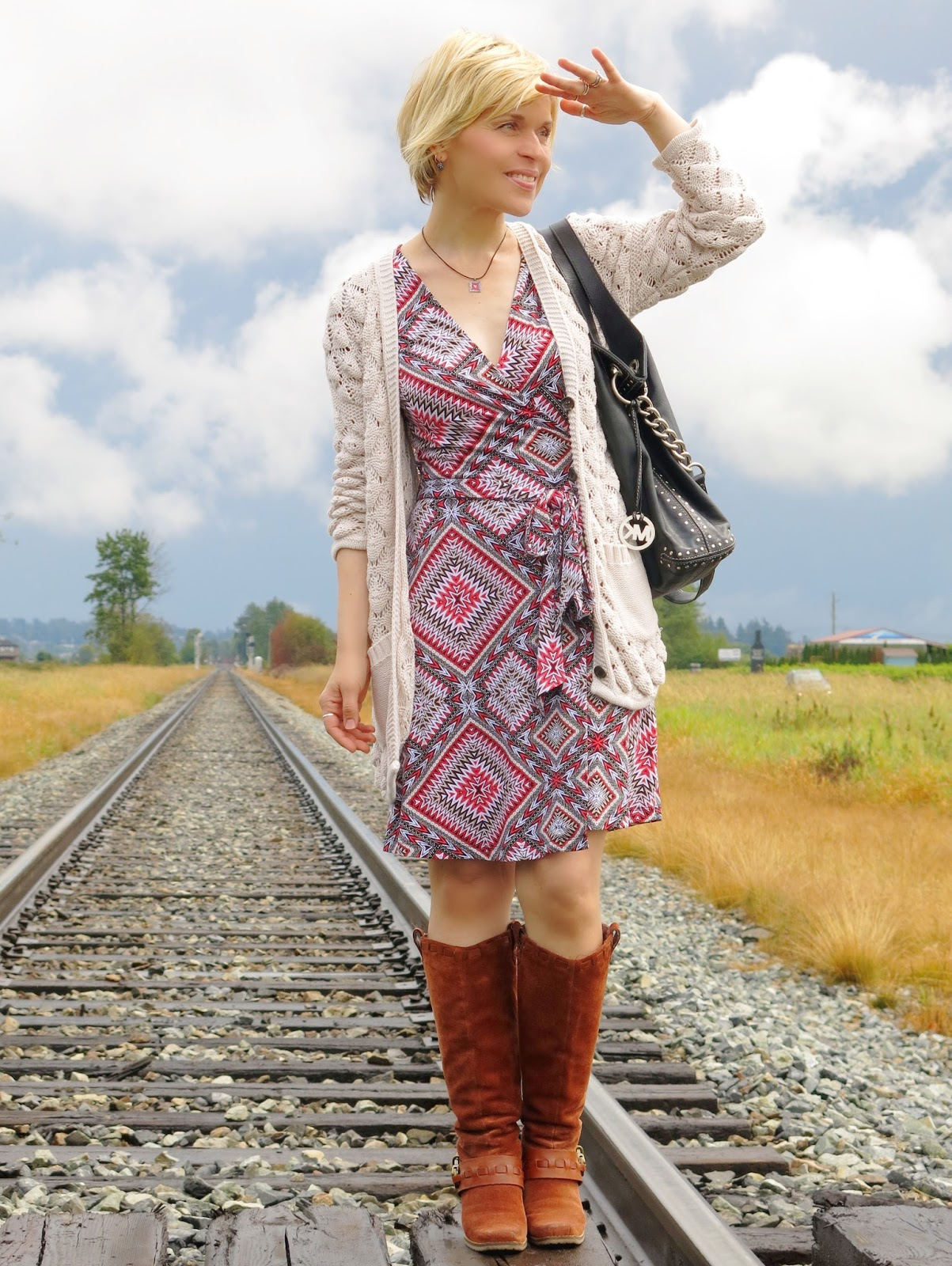 Hurry up and wait:  patterned wrap dress, grandpa cardigan, and stack-heeled boots