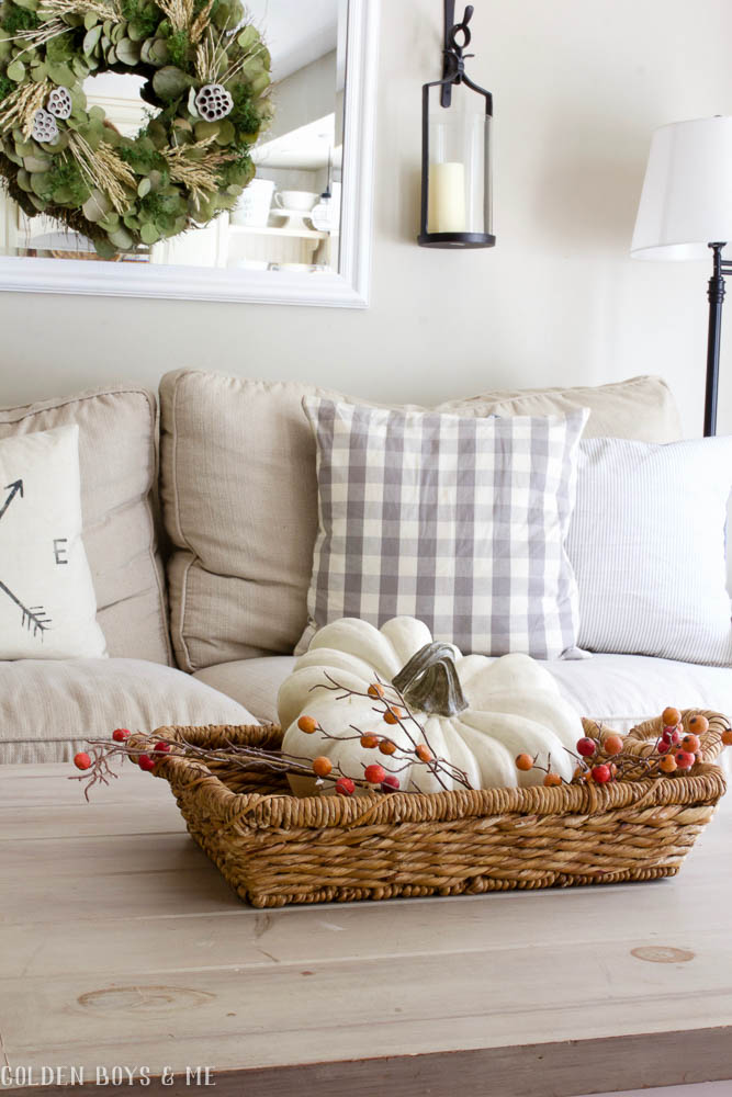 White pumpkin in basket with neutral fall decor