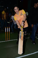 Sunny Leone in a Tight ORange T-Shirt playing Cricket