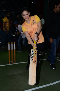 Sunny Leone in a Tight ORange T Shirt playing Cricket