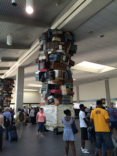 Art composed of old-fashioned luggage at baggage claim in Sacramento